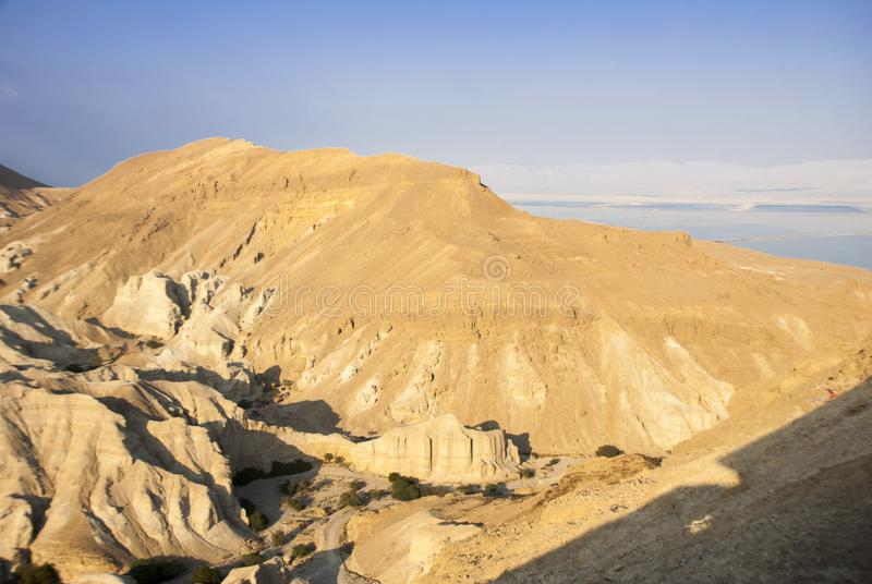 Desert hills and reflective Salty dead Sea and many others stock photo