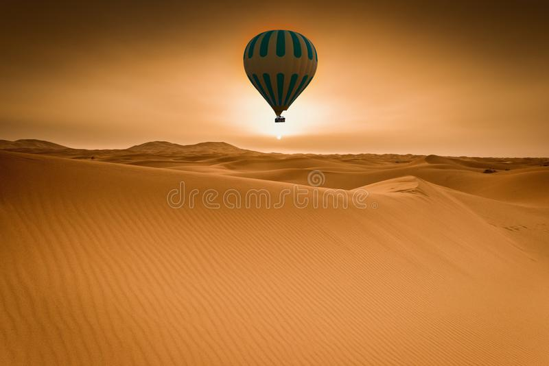 Desert and hot air balloon Landscape at Sunrise stock images