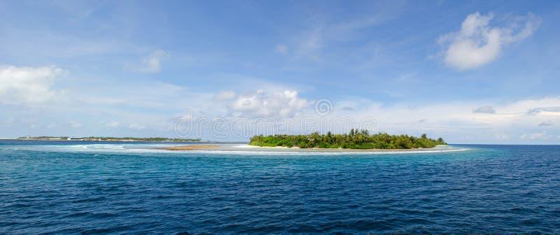 Desert island in sea stock photos
