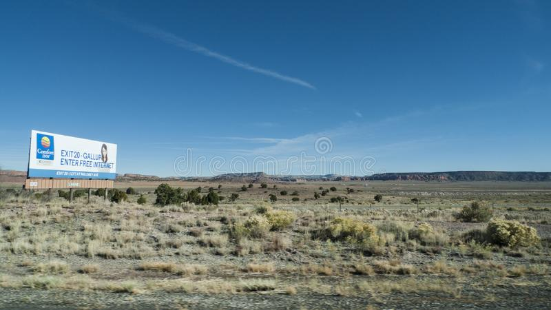 Gallup, New Mexico Comfort Inn Billboard in the desert royalty free stock photos