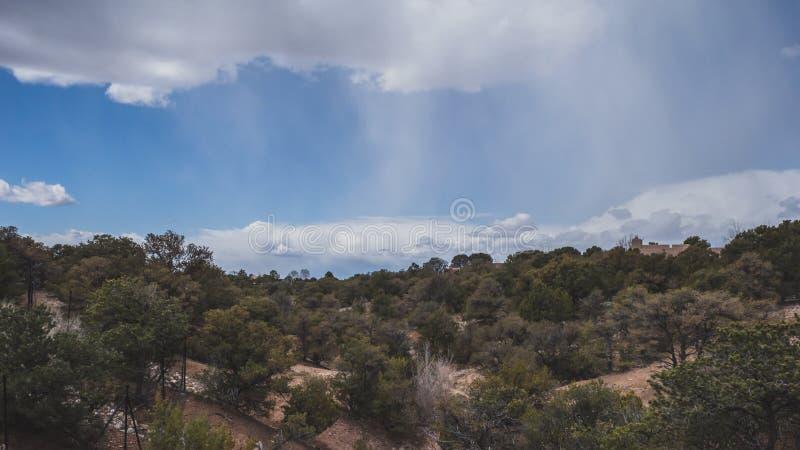 Desert landscape near Santa Fe, New Mexico, USA. Desert landscape with trees under blue sky and clouds, in Museum Hill, Santa Fe, New Mexico, USA royalty free stock photo
