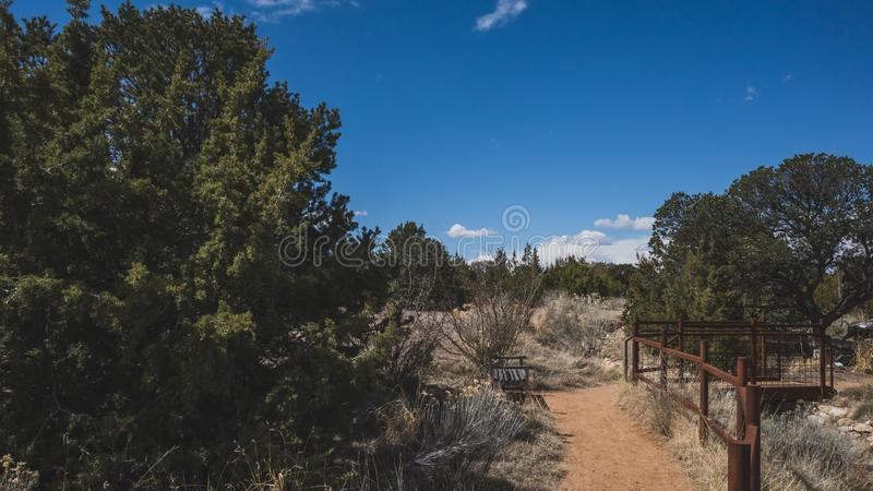 Desert landscape near Santa Fe, New Mexico, USA. Desert landscape with trees under blue sky and clouds, in Museum Hill, Santa Fe, New Mexico, USA stock image