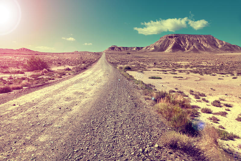 Desert landscape and road.Sunset scenic stock photography