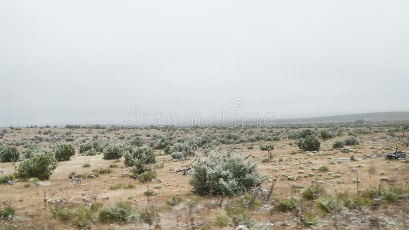 Eastern New Mexico landscape with light snow. Desert landscape with small shrubs and a light dusting of snow. November weather in New Mexico stock photography