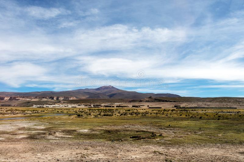 Desert landscapes with mountains in Bolivia at the dry season, dry vegetation is a natural background. Rocky and arid mountain landscape : Desert valley with royalty free stock images