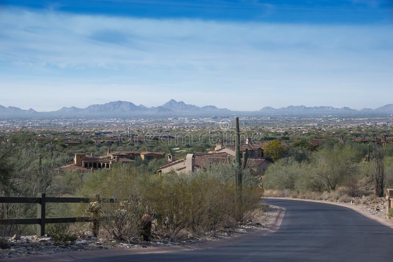 Desert life in Scottsdale,Az with view looking at Pheonix. Desert life in Scottsdale, view of Pheonix,Arizona,USA facing South West from McDowell Mountains in stock photo