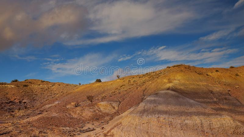Desert and mountains clouds over the southwestern USA New Mexico desert. View of Shiprock rock royalty free stock photos