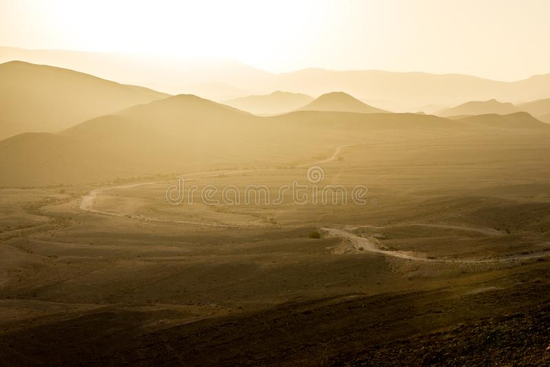Desert mountains road sunset light, south Israel landscape. royalty free stock images