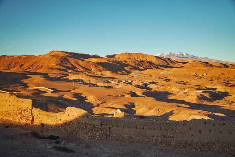 Desert near Ait Ben Haddou ksar lit by evening sun stock images