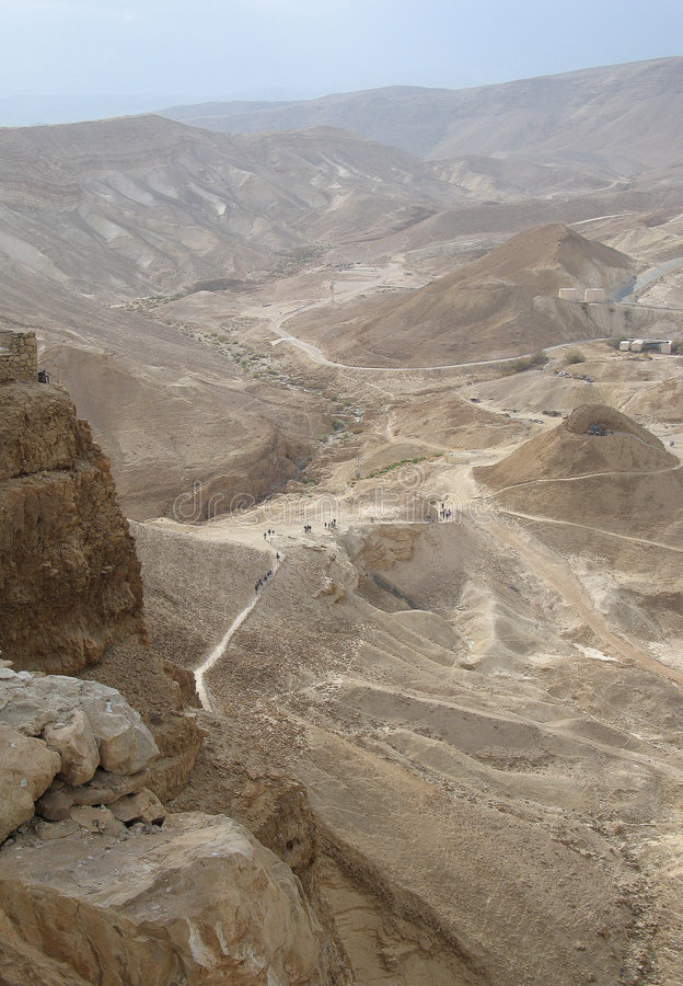 Desert near Masada. Masada is the name for a site of ancient palaces and fortifications in the South District of Israel on top of an isolated rock plateau, or royalty free stock photo