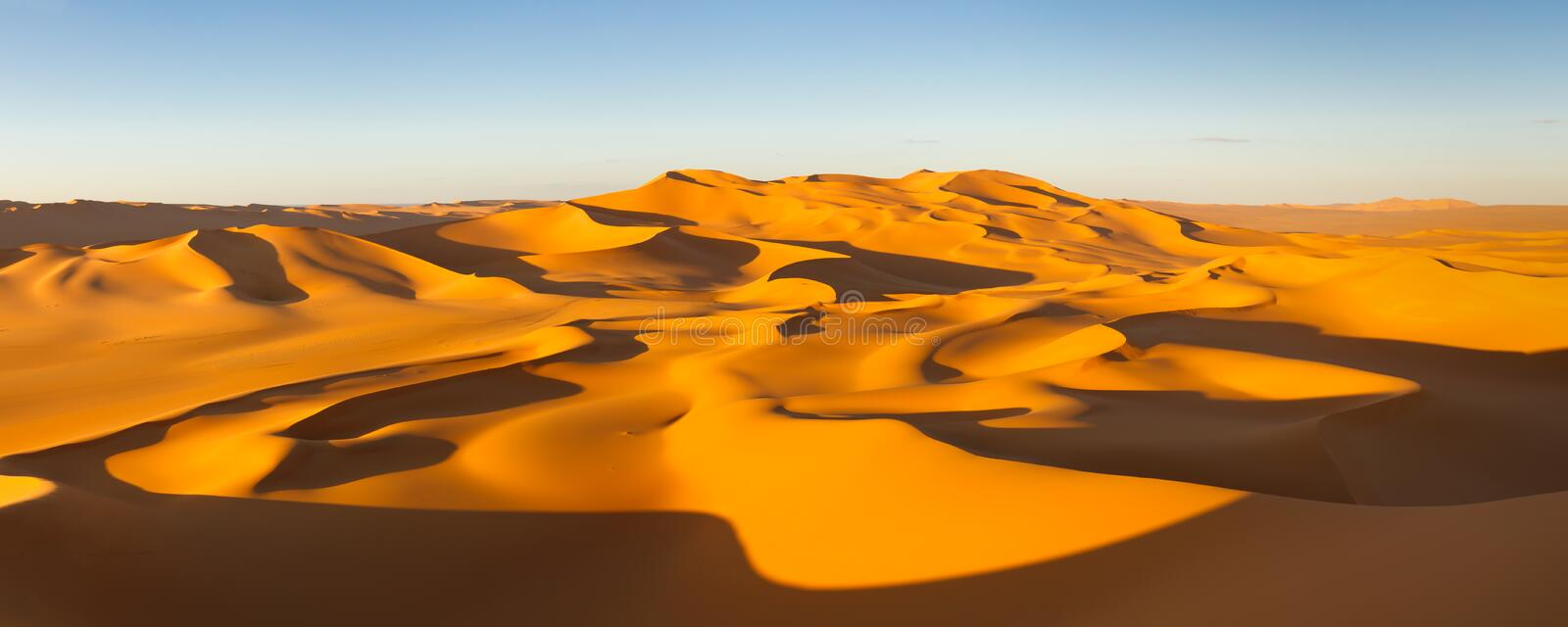 Desert Panorama - Sand Dunes - Sahara, Libya. Desert Panorama - Endless sand dunes at sunset - Murzuq Desert, Sahara, Libya stock photos