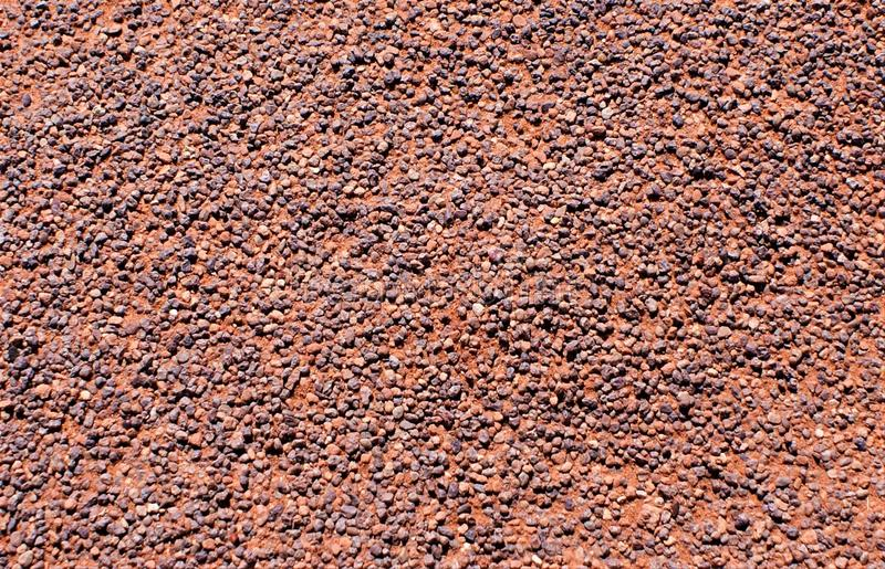 Desert pavement covered in remaining pebbles. Desert varnish covers pebbles covering oxidized sandstone of the American southwest. Uncovered of smaller sand royalty free stock photo