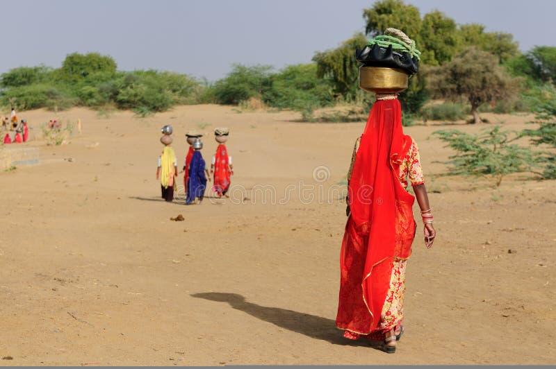 Desert, people, water stock image