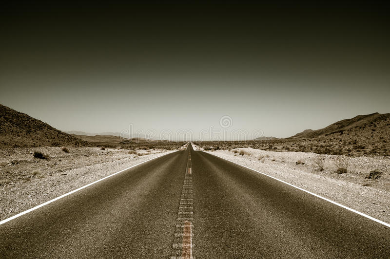 Desert road highway in death valley national park. Color toned stock photography