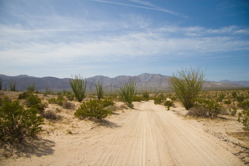 Desert Road to Borrego Badland. A desert sand road leading into the Borrego Badlands royalty free stock images