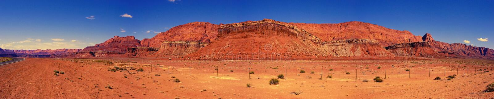 Desert Rock Panorama in Marble Canyon, Arizona. A desert roadside panorama of crumbling red mesas, cliffs, and other rock formations near Marble Canyon, part of stock photography