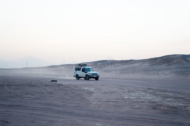 Desert safari suv car driving through sand dunes, Hurghada, Egypt royalty free stock image