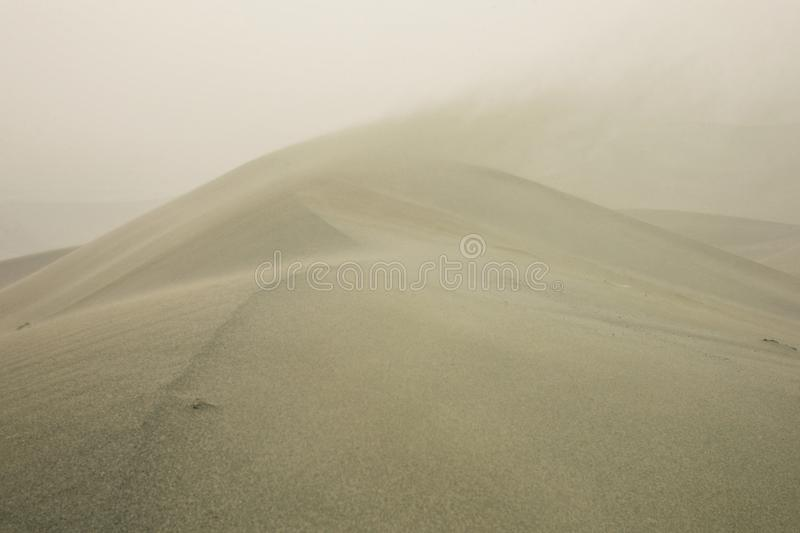 Desert sand dunes during a furious storm. Dunhuang / China - MAY 24 2011 : desert sand dunes during a furious storm royalty free stock photography