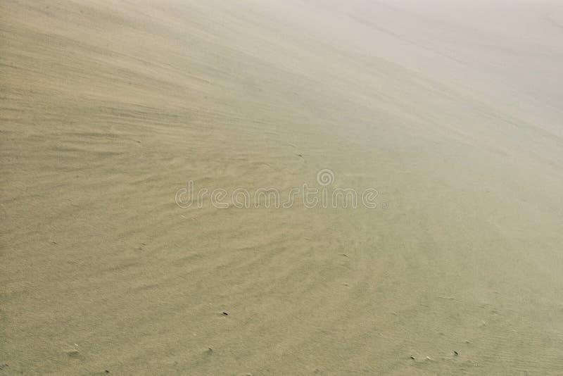 Desert sand dunes during a furious storm. Dunhuang / China - MAY 24 2011 : desert sand dunes during a furious storm stock photography