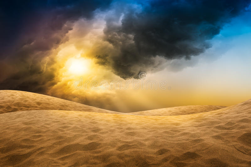 Desert sand with storm cloud. Desert sand with motion blur storm cloud in sunset time stock image