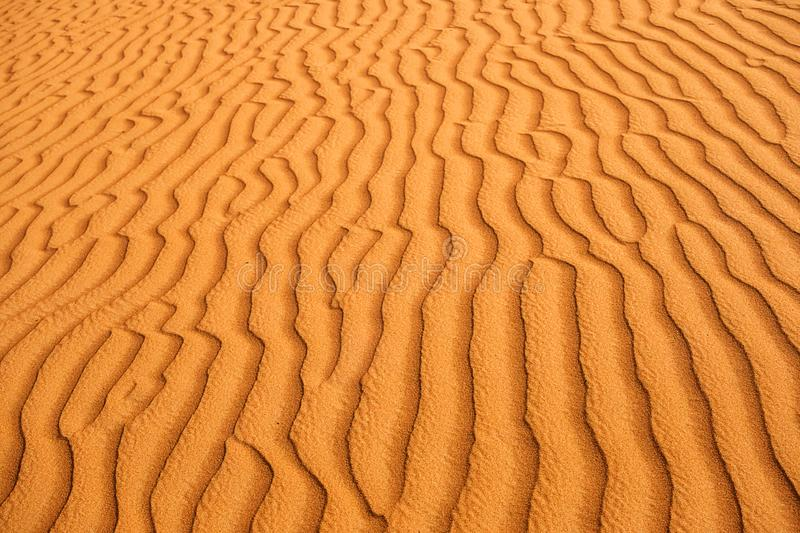 Desert sand textured patterns caused by wind. Beautiful background textured patterns in the desert sand dunes naturally done by wind royalty free stock photos
