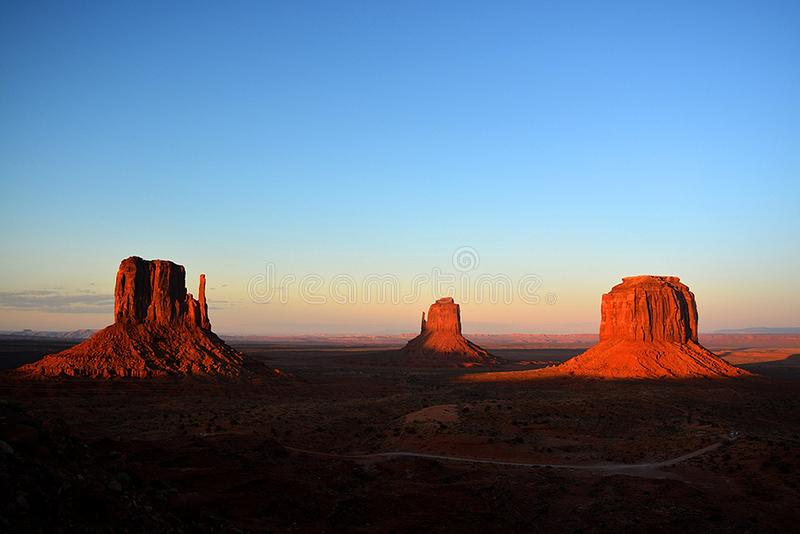 Scenic view of Monument Valley at sunset in Utah, United States. Desert Scenic view of Monument Valley at sunset in Utah, United States royalty free stock photography