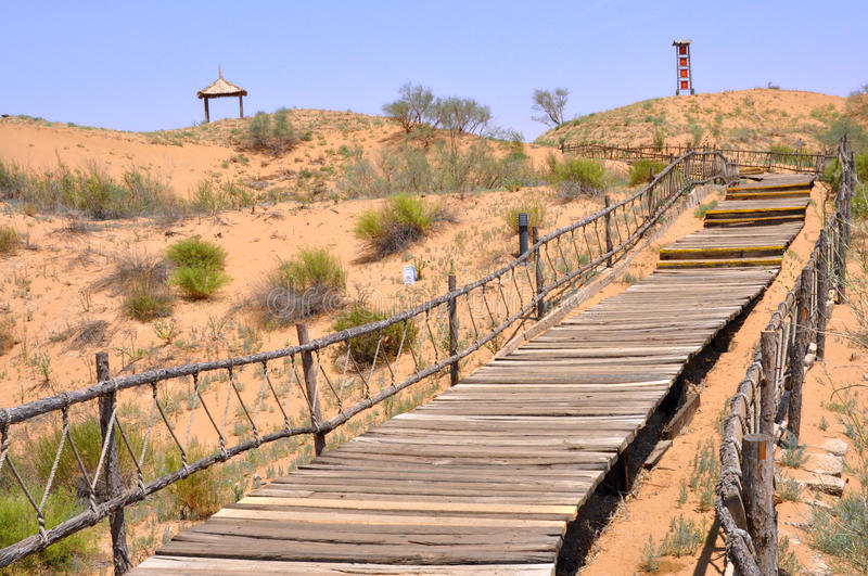 Wood Walkway in Tengger Desert. Desert in Shapotou which on the northern bank of the Yellow River, at the southern edge of the Tengger Desert in ZhongWei,Ningxia stock photos