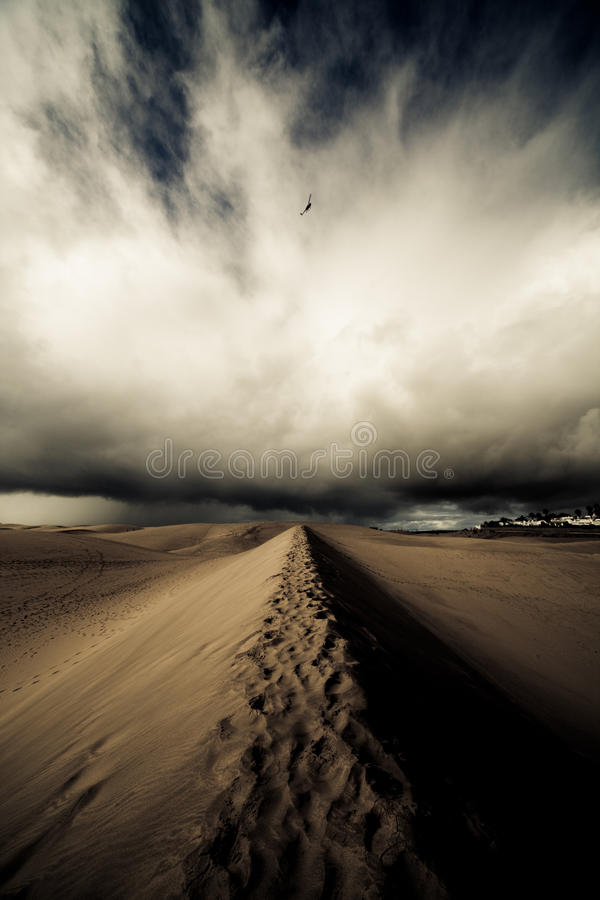 Desert Storm. Weather Storm in africa desert and helicopter in dark sky royalty free stock photo