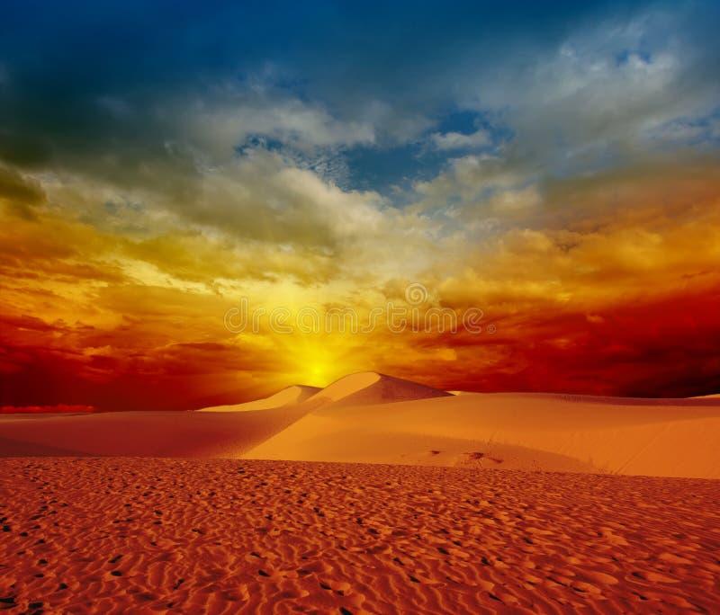 Desert sunset. Sandy desert at sunset time stock images