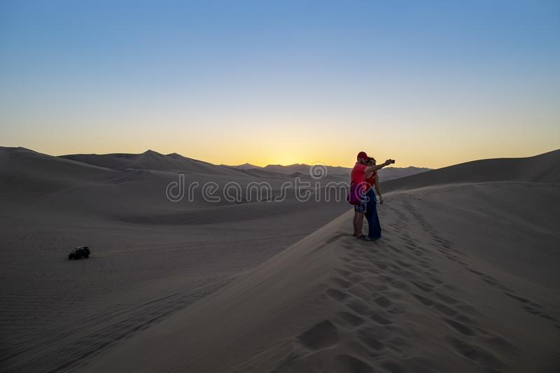 Desert during sunset at Huacachina Oasis in Ica, Peru stock photography