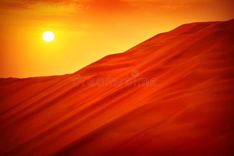 Desert sunset landscape. Hot dry wilderness, beautiful panoramic scene, sandy orange hills, extreme travel, heat concept royalty free stock photos