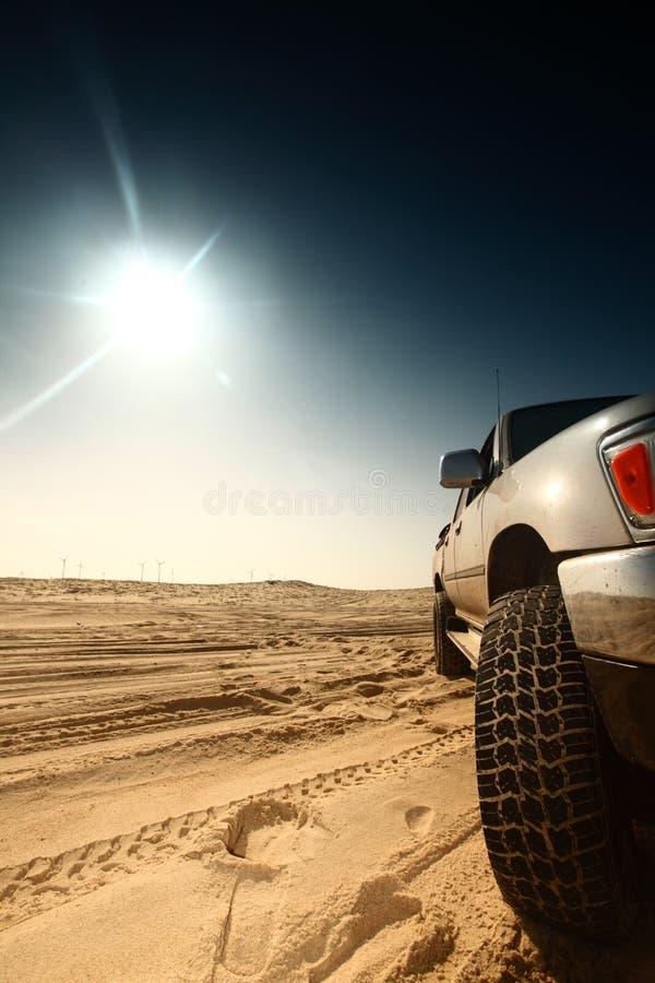 Desert truck. Truck in desert sand and blue sky stock images