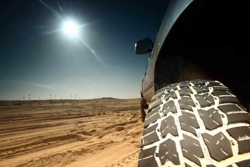 Desert truck. Truck in desert sand and blue sky royalty free stock image