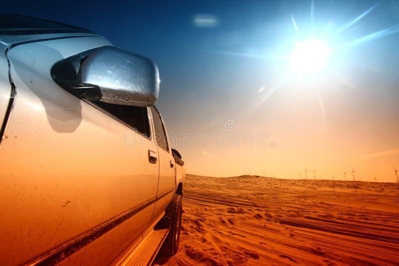 Desert truck. Truck in desert sand and blue sky royalty free stock photography