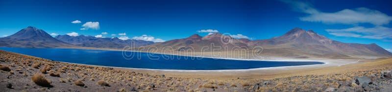 Desert volcanoes and lake stock image