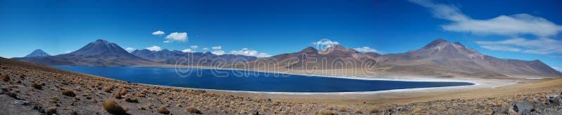 Desert volcanoes and lake royalty free stock image