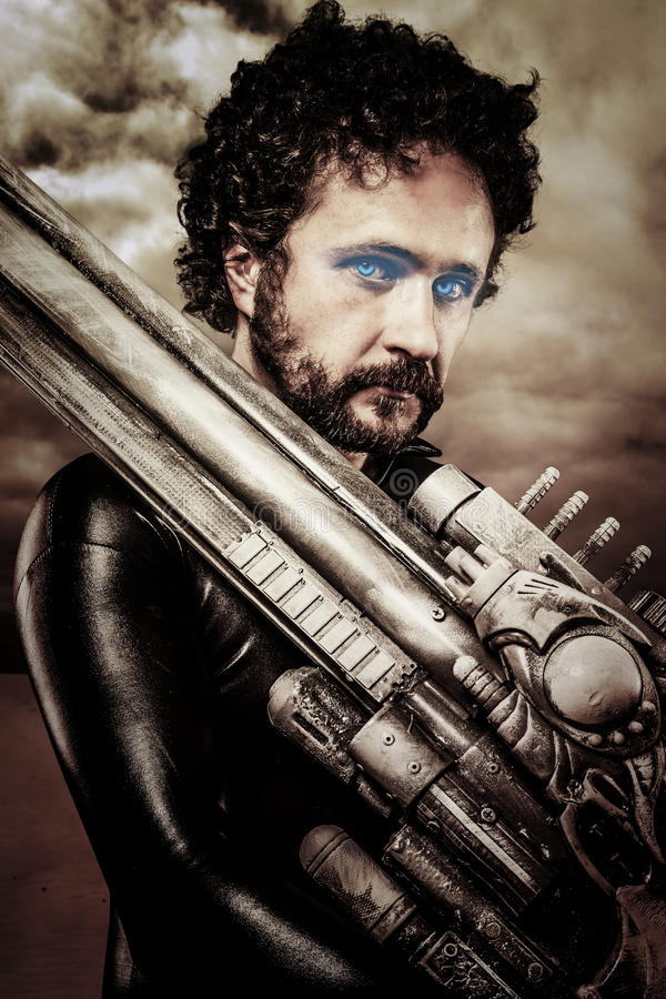 Free Desert Warrior With Big Gun Wearing A Latex Armor Royalty Free Stock Images - 30951249