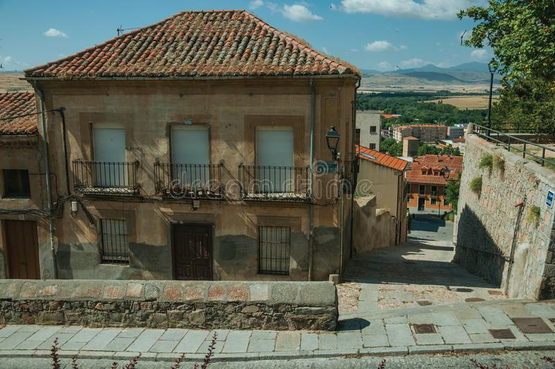 Deserted alley and old building with balcony at Avila stock images