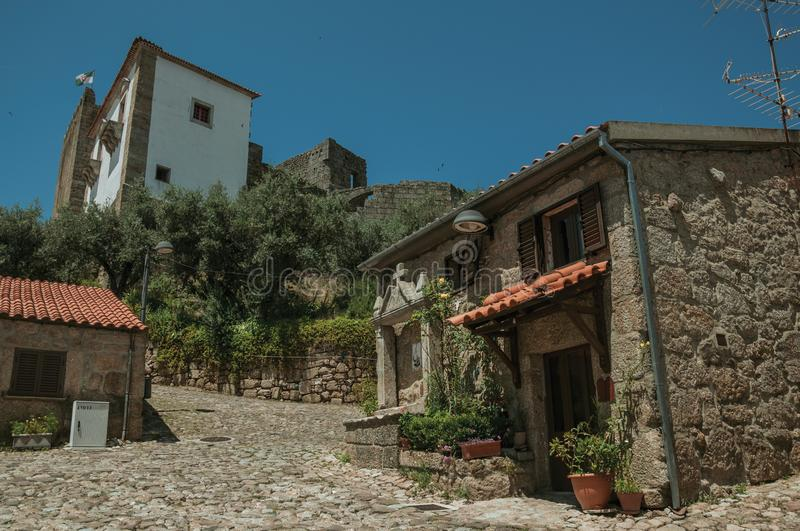 Deserted alley and old small house with stone walls stock image