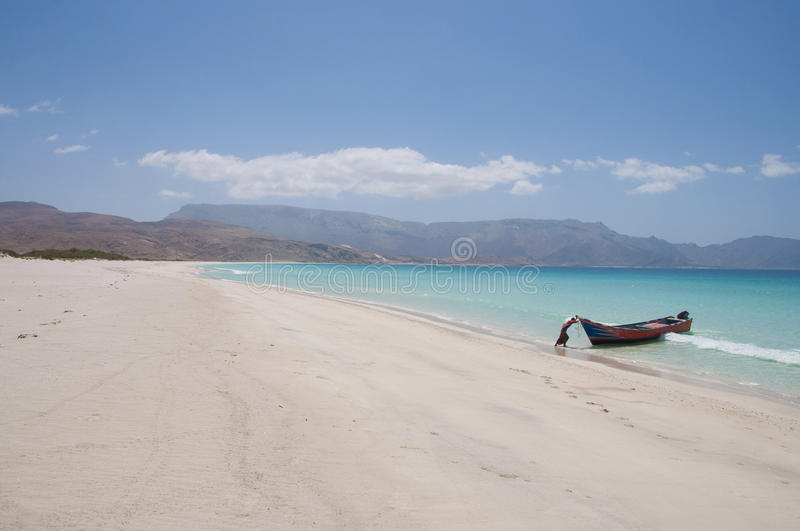 Deserted beach with fishing boat. Socotra island royalty free stock image