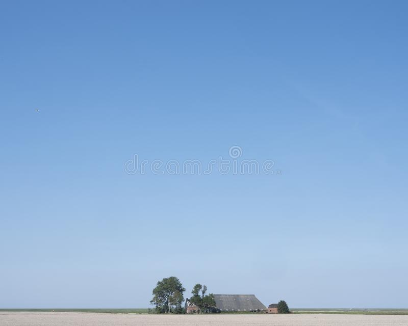 Deserted farm in the north of dutch province groningen on sunny summer day royalty free stock images