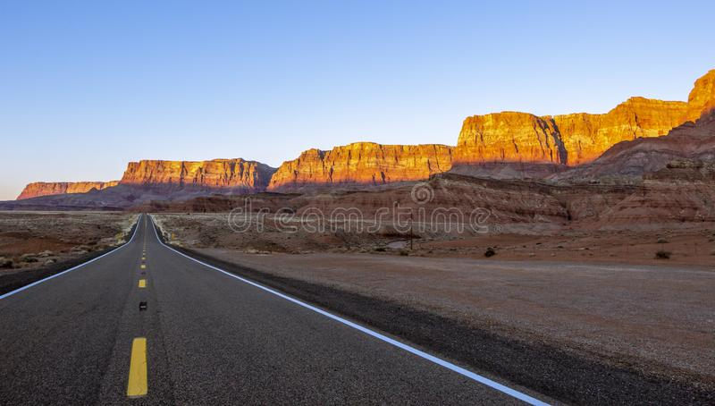 Deserted Highway In the Desert Southwest USA. In Nothern Arizona with red rock cliffs royalty free stock photos