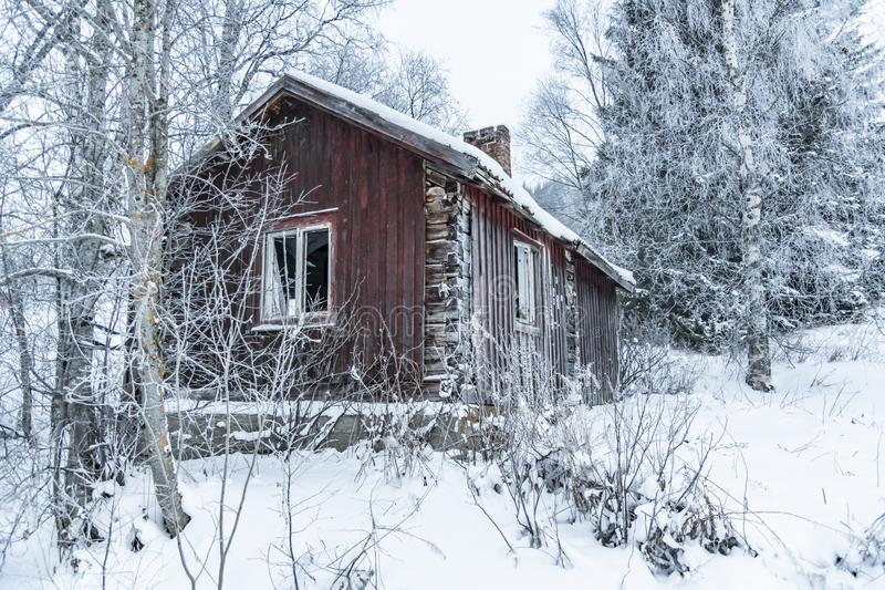Deserted old timber house wintertime Sweden stock images