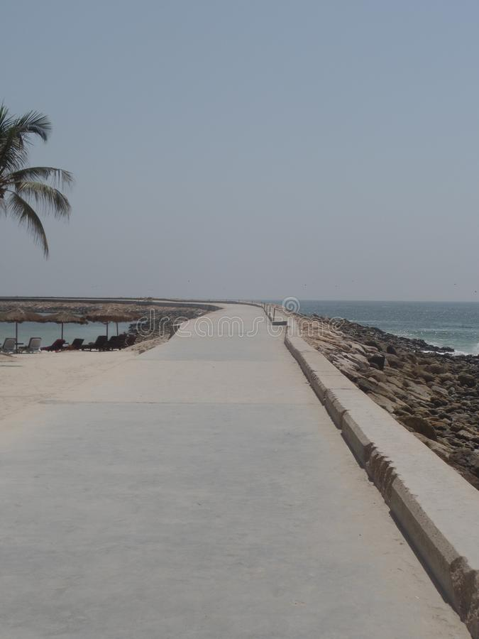 A deserted pier on the beautiful coast of Oman royalty free stock image