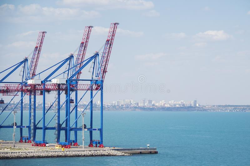 Deserted port terminal in a harbour for loading and offloading cargo ships and freight with rows of large industrial cranes to lif royalty free stock photo