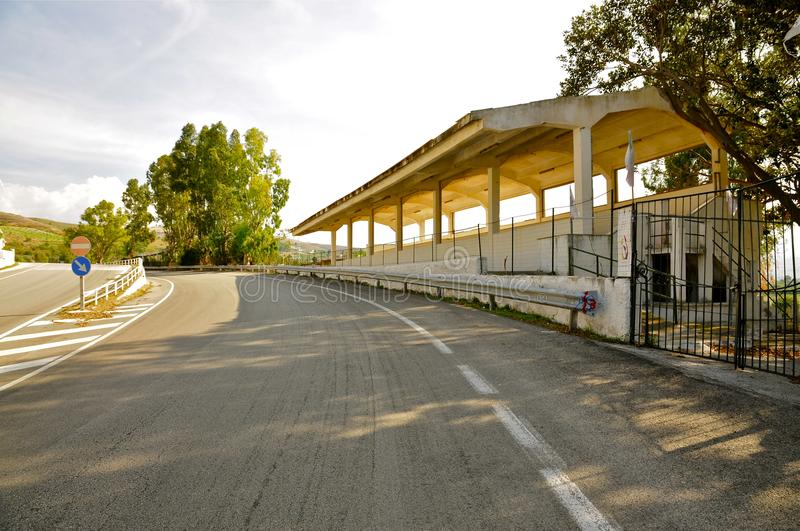 Deserted Racing Complex Grandstand, Floriopolis, Cerda, Sicily. Road and Grandstand of the Historic Targa Florio Circuit, the oldest Sports Car Racing Event in royalty free stock photos