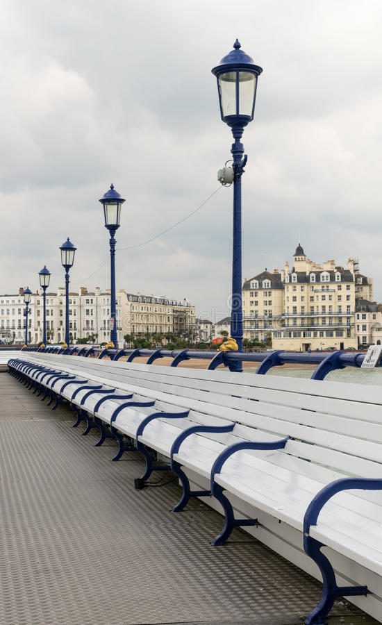 Deserted seats on pier in Eastbourne UK stock images