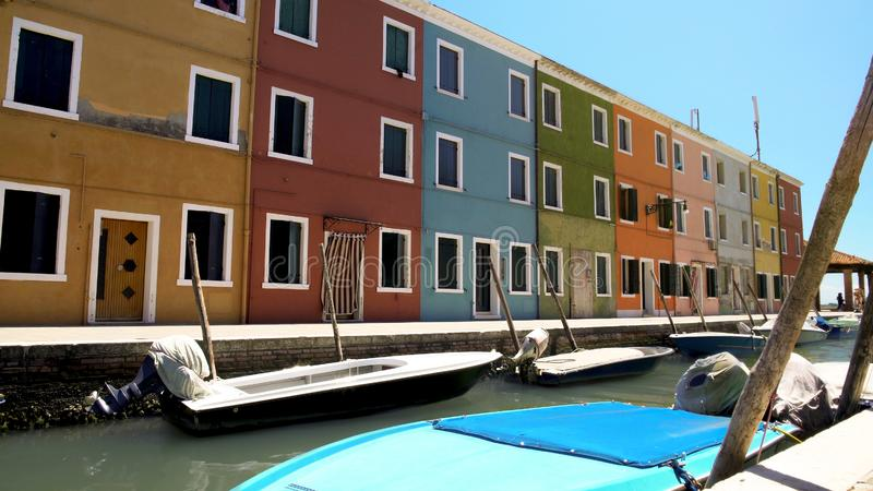 Deserted street of Burano island, colorful houses with closed windows, Venice royalty free stock images