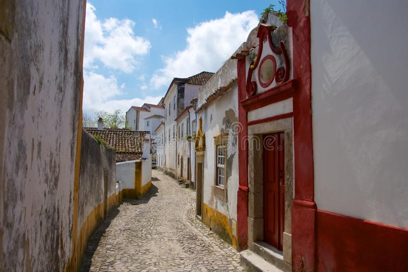 Deserted street with white houses and red door stock image