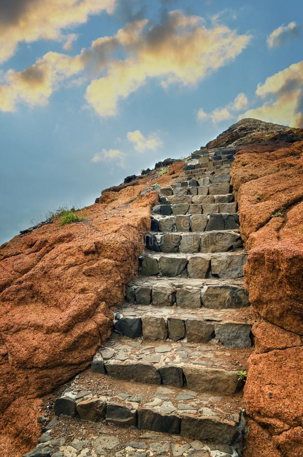 Volcanic rock with stone stairs towards the sky stock photo